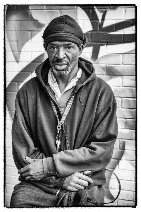 Older Black Man on Stool Holding Headphones